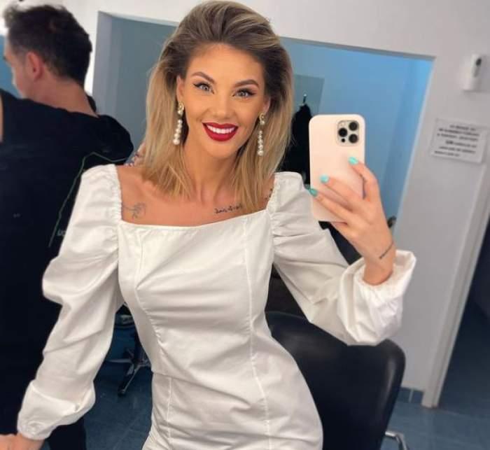 Ramona Olaru în rochie albă.