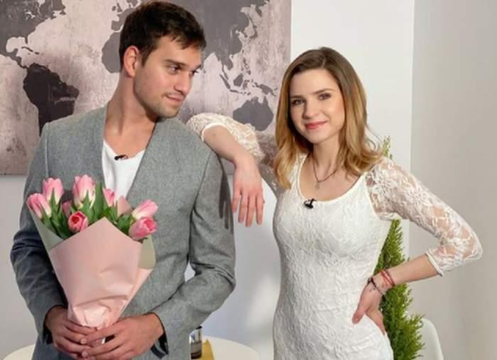 Cristina Ciobănașu in rochie alba si vlad gherman langa ea cu un buchet de flori in mana