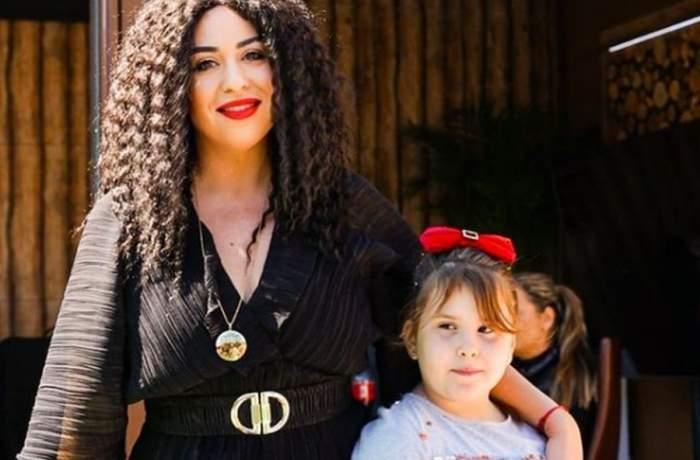 oana roman cu peruca pe cap alaturi de fiica ei izabela