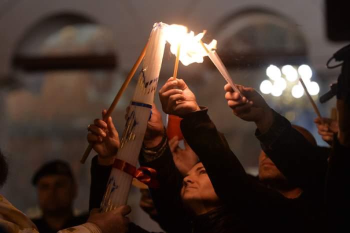 Lumina Sfântă a Învierii s-a aprins la Mormântul de la Ierusalim. Mii de credincioși s-au adunat să vadă minunea / VIDEO