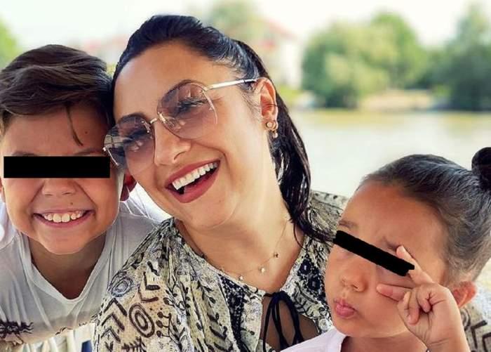 Andra și copiii ei se află pe un lac. Vedeta și David zâmbesc, iar Eva ține buzele țuguiate și face semnul păcii cu o mână.