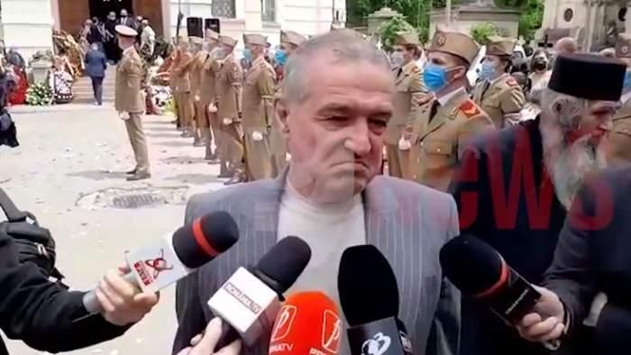 """Gigi Becali, declarații emoționante la înmormântarea lui Ion Dichiseanu: """"Aveam o prietenie cu el"""" / VIDEO"""