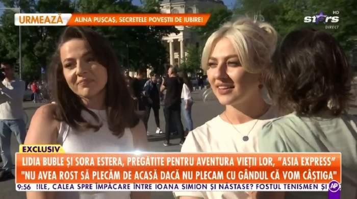 Lidia Buble și sora ei dau un interviu la Antena Stars. Artista ține în brațe un copil.