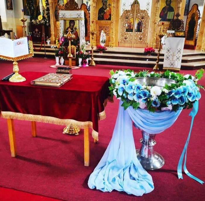Preotul acuzat de moartea bebelușului la botez a fost găsit nevinovat potrivit raportului medico-legal! Familia copilului contestă rezultatul
