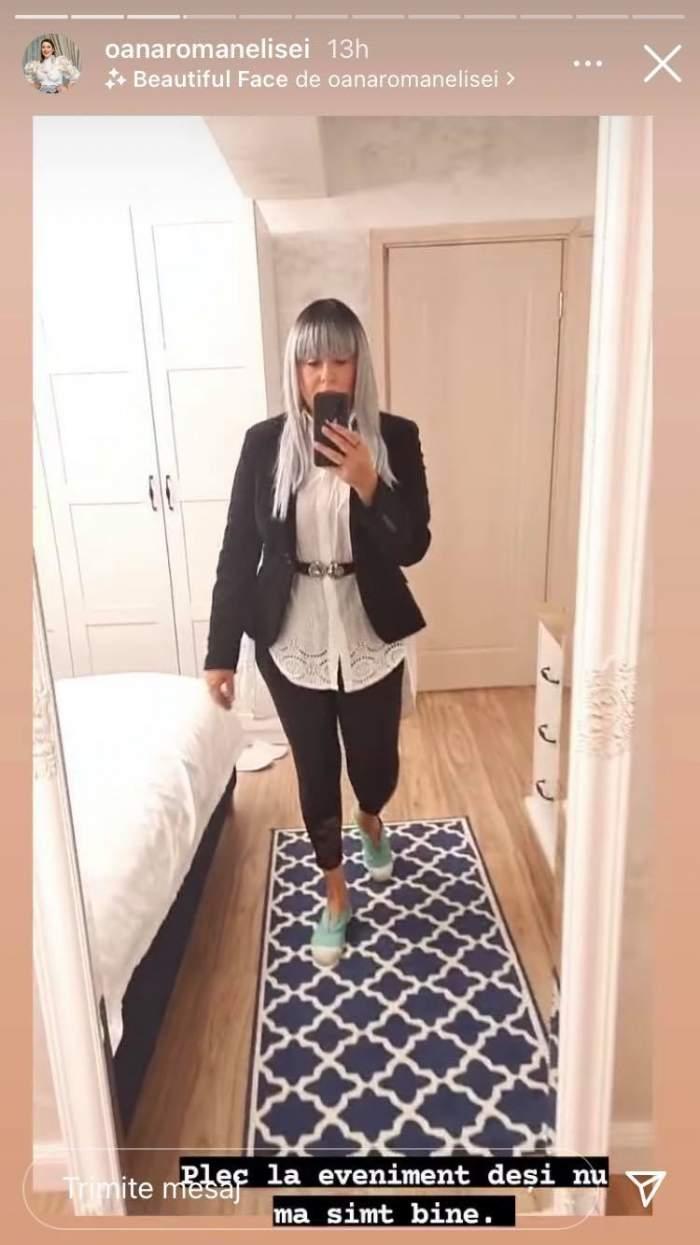 Oana Roman poartă o perucă gri și se filmează în oglindă.