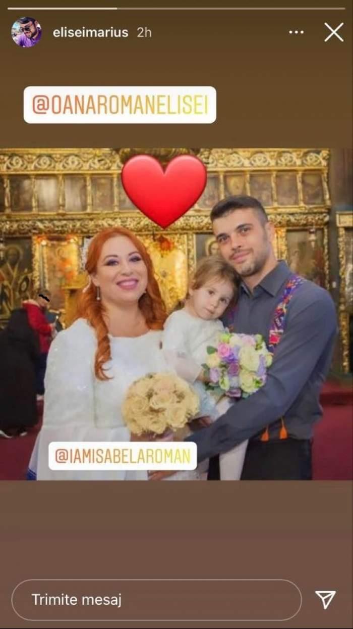Oana Roman, Marius Elisei și fiica lor sunt la biserică. El poartă cămașă bleumarin și o ține în brațe pe Isabela, iar Oana Roman poartă rochie albă.
