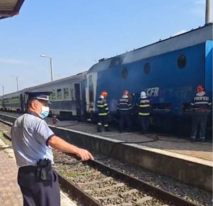 Alertă în gara de Sud din Târgoviște! O locomotivă a luat foc, la un tren de călători / FOTO