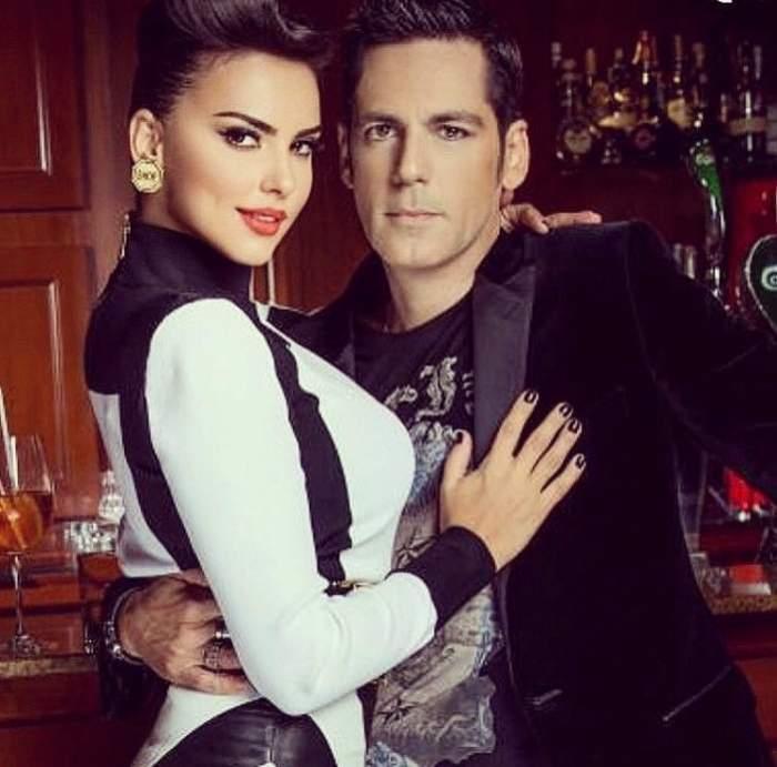 Ștefan Bănică Jr. și Lavinia Pârva, îmbrăcați în aln și negru, îmbrățișați