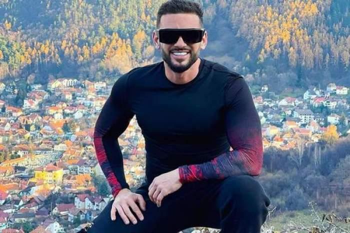 Dorian Popa, zâmbitor, îmbrăcatîn negru