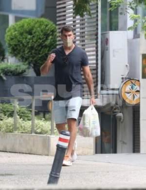 Horia Tecău, pe fugă prin oraș pentru a-și ține banii în buzunar. Tenismenul, cu greu a renunțat la câțiva lei / PAPARAZZI