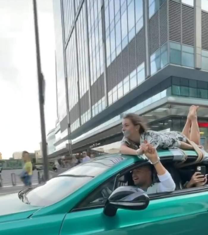 Un cunoscut influencer din Rusia şi-a legat iubita cu frânghia de plafonul maşinii, apoi s-a plimbat cu ea pe străzile oraşului / FOTO