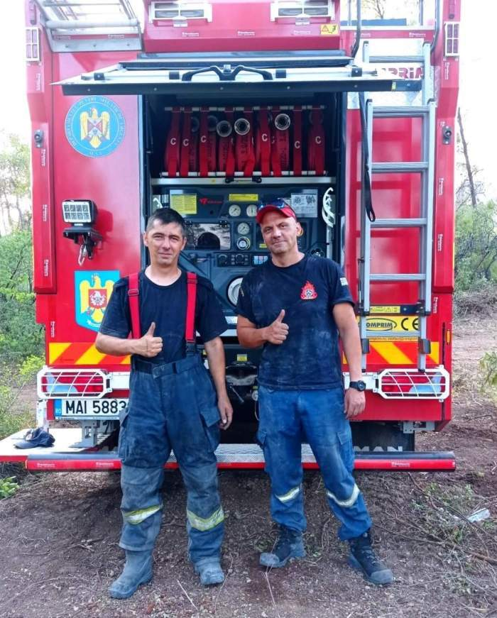 pompieri romani langa masina