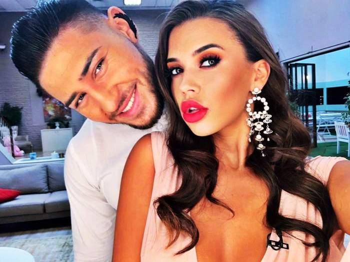 Bogdan Mocanu și iubita, îmbrăcați în alb și îmbrățișați