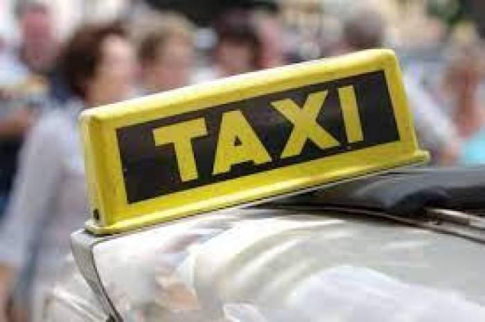 Semnul ce indică o mașină de taxi