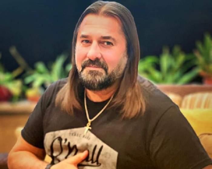 Gheorghe Gheorghiu, în tricou, zâmbitor