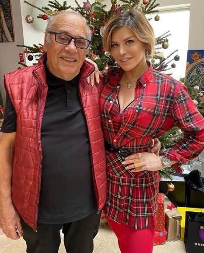 Loredana și Vasile Groza, îmbrăcați în roșu, îmbrățișați
