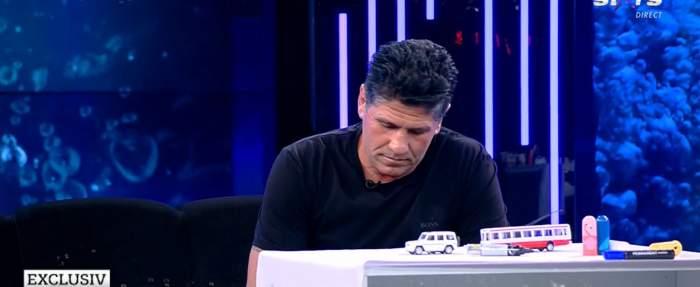 Stelian Ogică, la un pas de tragedie în urma unei șicanări în trafic? Un șofer de TIR l-a amenințat cu un ciocan apoi a dat cu utilajul peste el / VIDEO