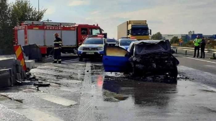 Accident grav între un autocar şi un autoturism pe Autostrada Pitești - București. În urma impactului, mașina a luat foc / FOTO
