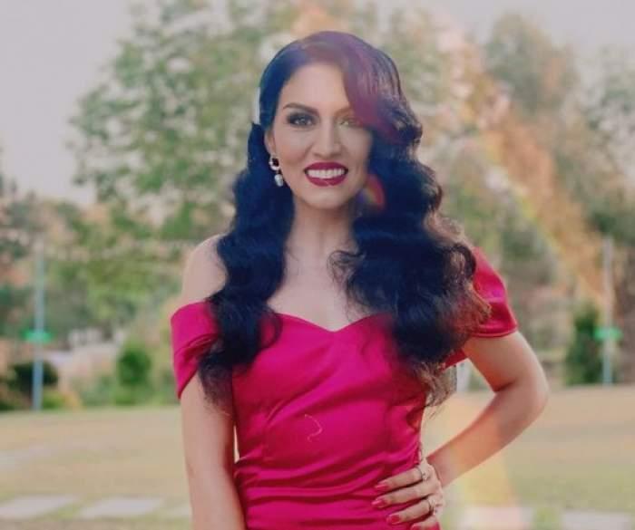 Doinița Oancea, în rochie roșie